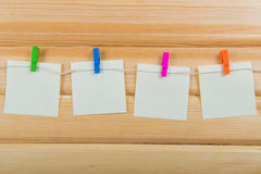 Notes on color clothespin Royalty Free Stock Images