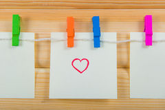 Notes on color clothespin Stock Photo