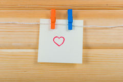 Notes on color clothespin Royalty Free Stock Photo