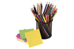 Notes and colored pencils Stock Photo