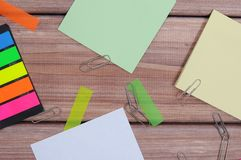 Notes. The composition of the colored notes on the wooden table Royalty Free Stock Images