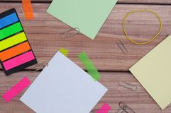 Notes. The composition of the colored notes on the wooden table Stock Photography