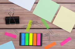 Notes. The composition of the colored notes on the wooden table Royalty Free Stock Photography