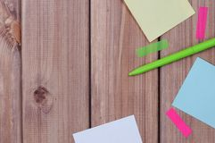 Notes. The composition of the colored notes on the wooden table Royalty Free Stock Image