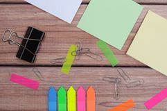 Notes. The composition of the colored notes on the wooden table Stock Images