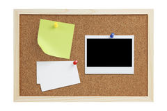 Notes on cork board. A sticky / adhesive note, plain business cards and a black polaroid photo pinned on a cork board isolated on white background. Plenty of Royalty Free Stock Images