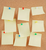Notes on corkboard Stock Image