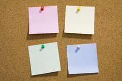 Notes on corkboard Royalty Free Stock Image