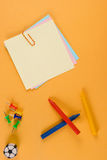 Notes, crayons, pins and eraser Stock Images