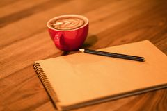 Notes with cup of hot coffee. And pan stock image