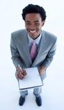 Notes d'écriture d'homme d'affaires dans un cahier Images stock