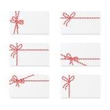 Notes de carte avec des arcs de cadeau Images stock