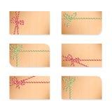 Notes de carte avec des arcs de cadeau Photos stock