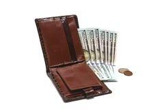 Notes des dollars US et des pièces de monnaie dans la bourse Photo libre de droits