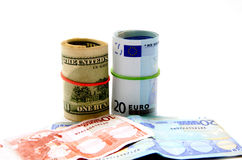 Notes of euros and dollars. In closeup over white background Royalty Free Stock Photos
