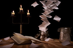 Notes flying over the table. Desk with an unusual tornado of notes Royalty Free Stock Photo