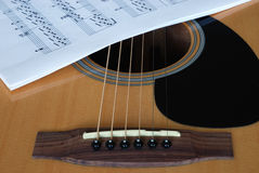 Notes on guitar. Detail of acoustic guitar with musical notes Royalty Free Stock Photos