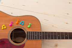 Notes and guitar. Music notes and classic guitar Stock Photography