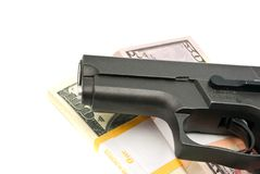 Notes and gun on white Stock Photography