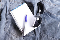Notes on Jeans. A notebook on some jeans trousers Royalty Free Stock Image
