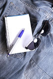 Notes on Jeans. A notebook on some jeans trousers Stock Photos
