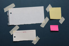 Notes with masking tape. On a green board Royalty Free Stock Photo