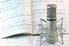 Notes and microphone. Notes background and music recording microphone studio tools stock images