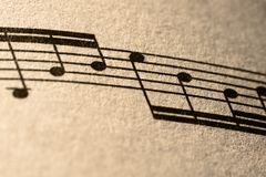 Notes of Music. Close-up detail of several musical notes printed on a piece of sheet music Royalty Free Stock Images