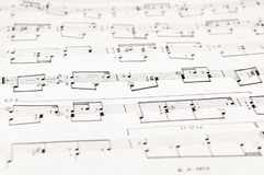 Notes and musical staves. Musical staves with five horizontal lines and different notes Royalty Free Stock Photo