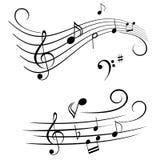 Notes musicales sur la barre Images stock