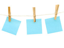 Notes at the peg. Blue blank notes at the peg against white background stock images