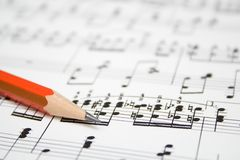 Notes and pencil. Modern musical notes and pencil background royalty free stock image