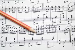 Notes and pencil. Modern musical notes and pencil background royalty free stock images