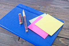 Notes and pens Royalty Free Stock Photos