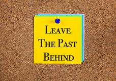 Phrase leave the past behind on corkboard. Notes with phrase leave the past behind on cork board Stock Images