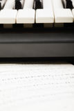 Notes and piano keyboard Stock Photo
