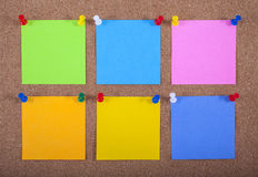 Notes Pinned onto a Noticeboard Royalty Free Stock Photos