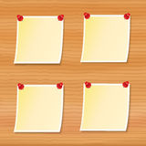 Notes pinned to wooden board Stock Images