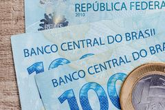 Notes of Real, Brazilian currency. Money from Brazil. Money from Brazil. Notes of Real, Brazilian currency. Concept of savings, salary, payment and funds. Three Royalty Free Stock Photography