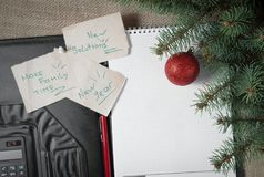 Notes reminders and goals, a business notebook, on the next new year background with Christmas fir branches with. A festive balloon Stock Photos