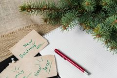 Notes reminders and goals, a business notebook, on the next new year background with Christmas fir branches. Notes reminders and goals for the next new year on Royalty Free Stock Images