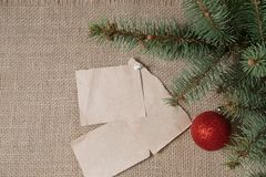 Notes reminders and goals for the next new year on the background of fir branches and Christmas ball Royalty Free Stock Photos