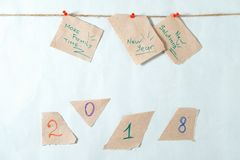 Notes reminders and goals for the next new year on a linen rope. With white background and red pins Stock Photography
