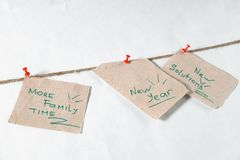 Notes reminders and goals for the next new year on a linen rope. With white background and red pins Stock Image