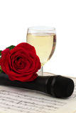 Notes rose glass of champagne microphone isolated Royalty Free Stock Image