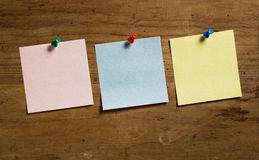Notes with Tack. Three Notes with Tack on wooden board, in three different colors Stock Images