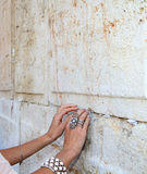 Notes in western wall. Young woman put a note to god in western wall royalty free illustration