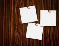 Notes on wood background Stock Images