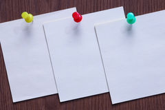 Notes on the wooden background. Three sticks Royalty Free Stock Image