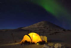 Nothern lights. Aurora borealis, Northern Lights, over a tent in the snow in Swedish Lapland Stock Photo